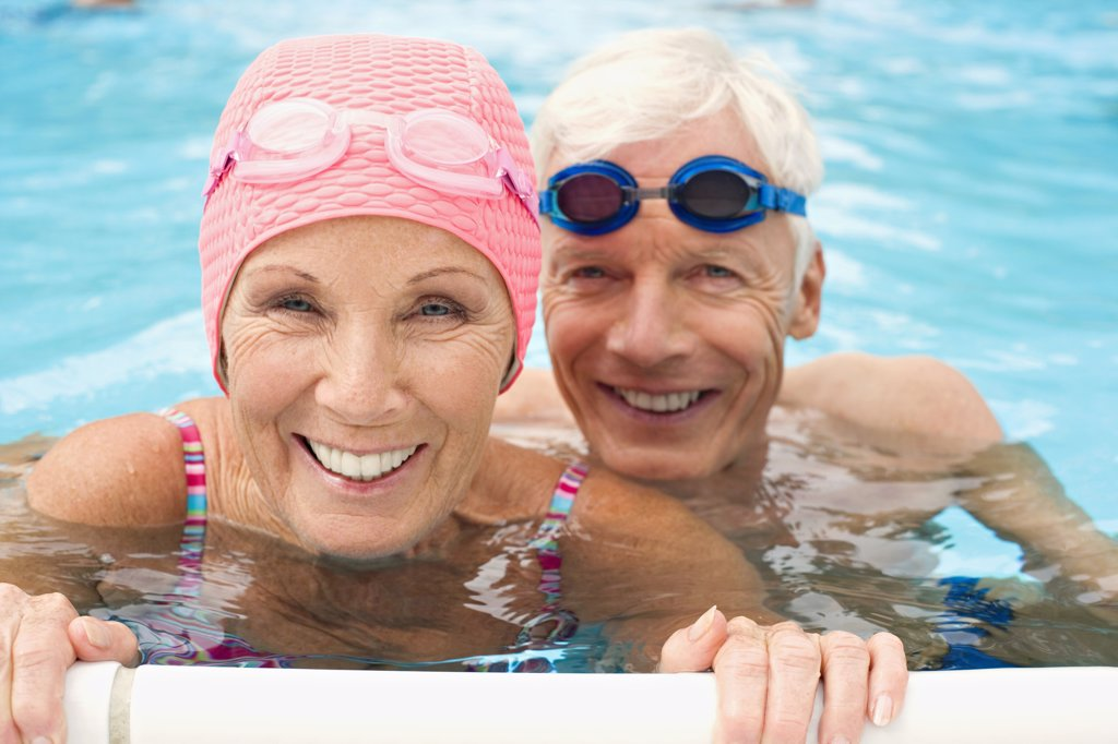 Germany, Senior couple in swimming pool : Stock Photo
