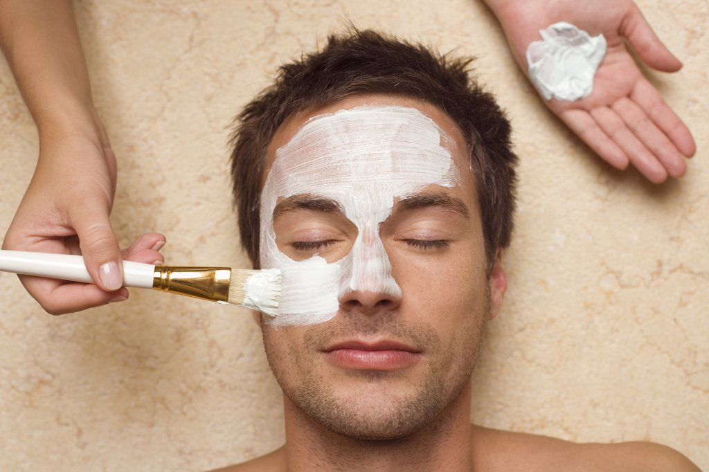 Germany, man getting a facial, close-up : Stock Photo