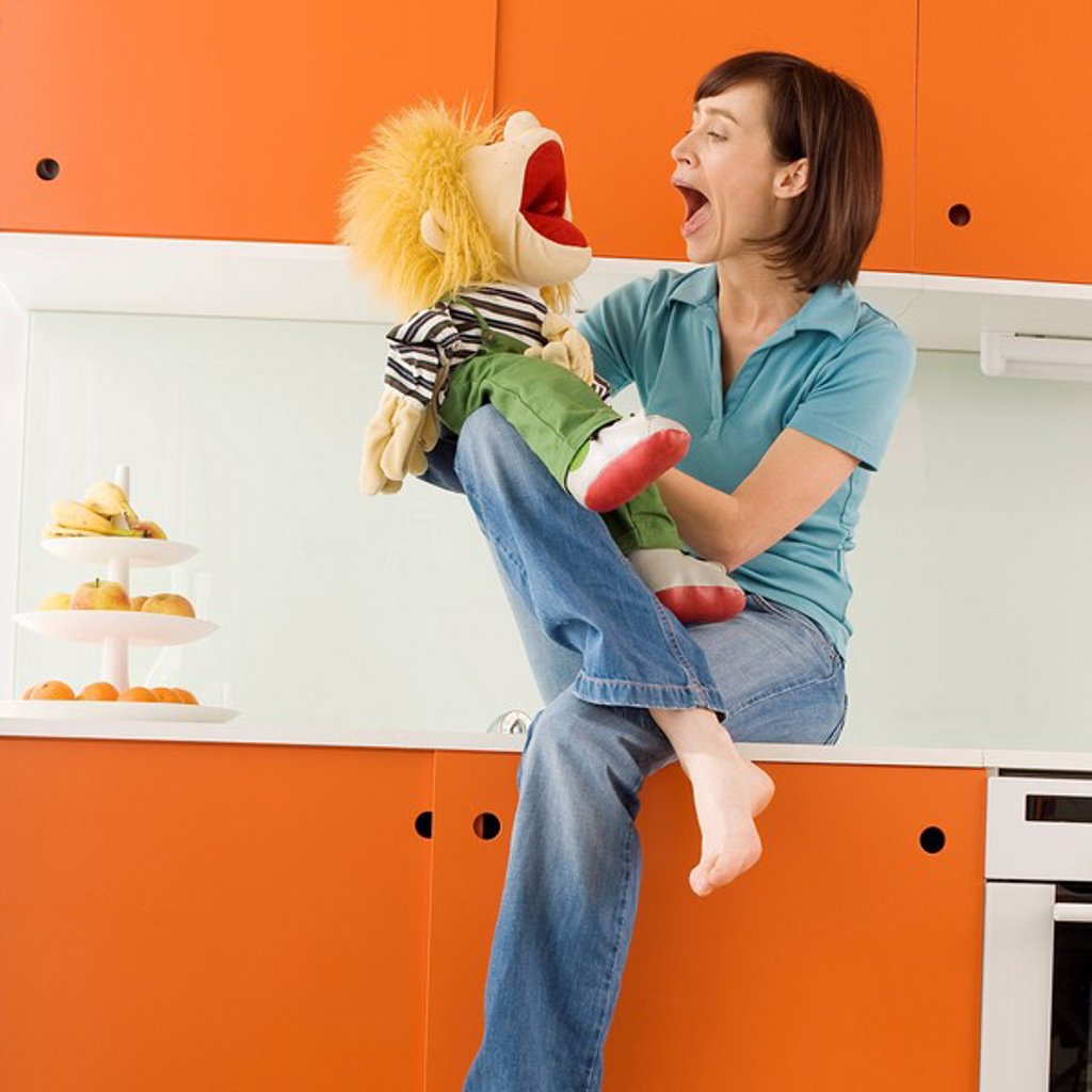 Young woman with puppet : Stock Photo