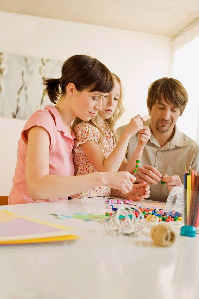 Stock Photo: 1815R-33961 Family is making a neckclace