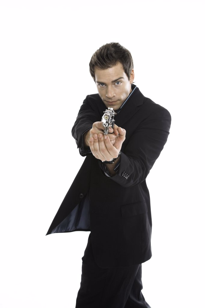 Stock Photo: 1815R-35352 Young man holding hand gun, close-up