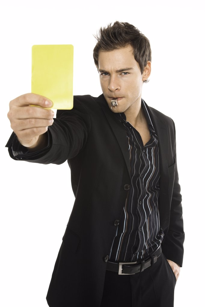 Stock Photo: 1815R-35370 Young man showing yellow card, close-up