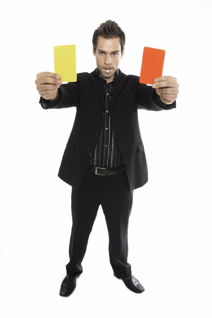 Young man holding red and yellow card close-up : Stock Photo