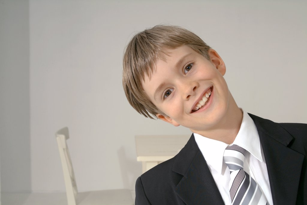 Boy dressed for First Communion, portrait : Stock Photo