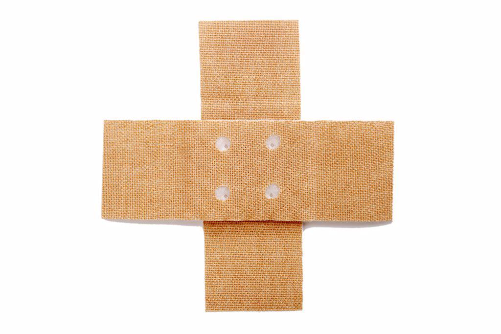 Stock Photo: 1815R-36167 Cross adhesive bandages, close-up