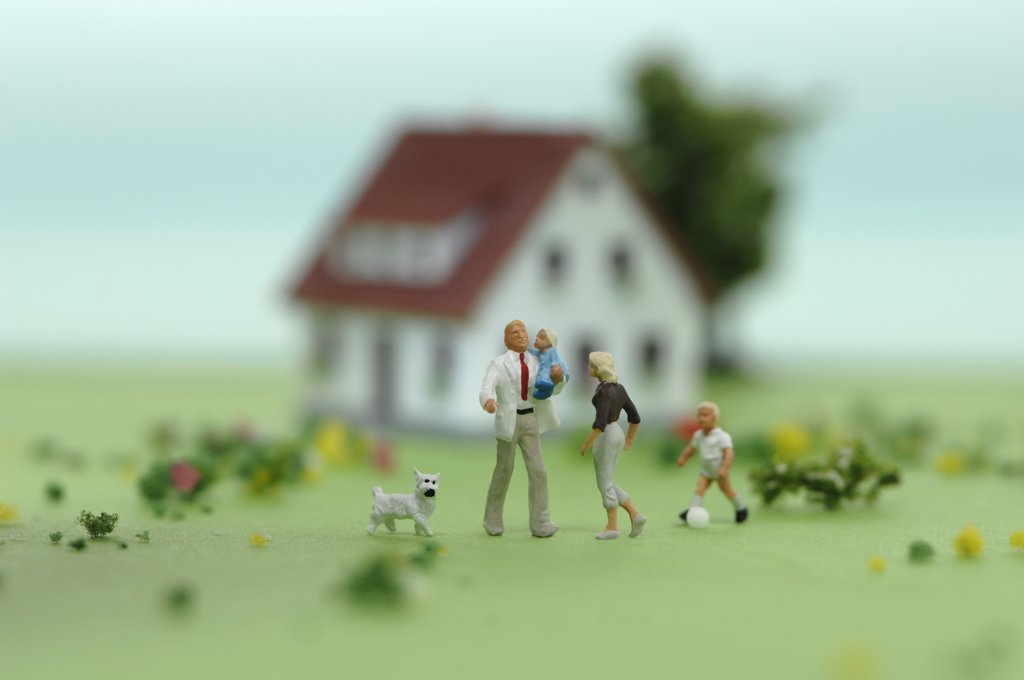Plastic figurines in front of house : Stock Photo