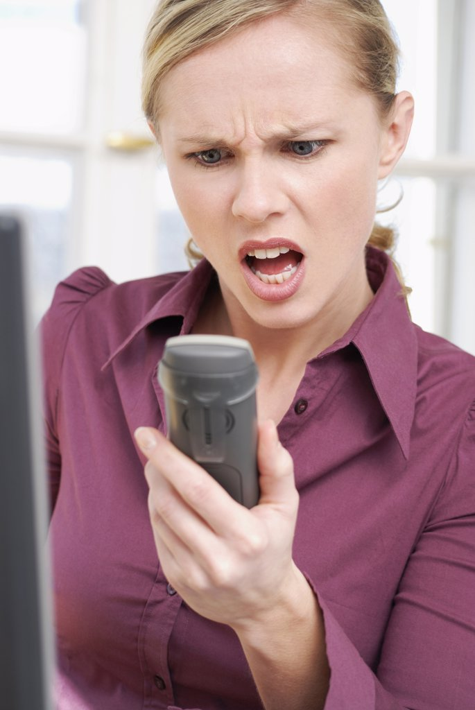 Woman shouting in telephone, close-up : Stock Photo