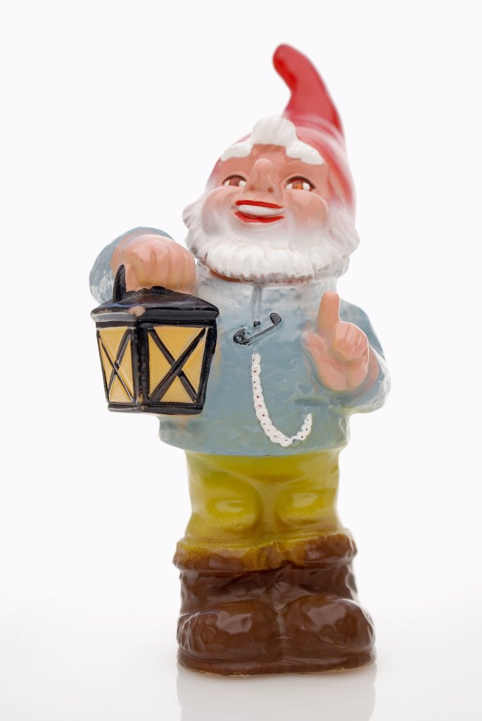 Garden gnome with lantern : Stock Photo
