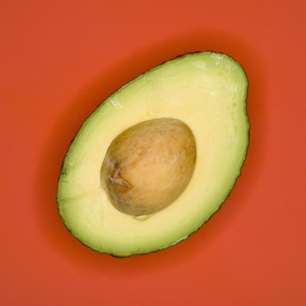 Avocado, cross section, elevated view : Stock Photo