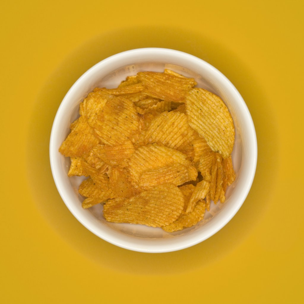 Bowl of crisps, elevated view : Stock Photo
