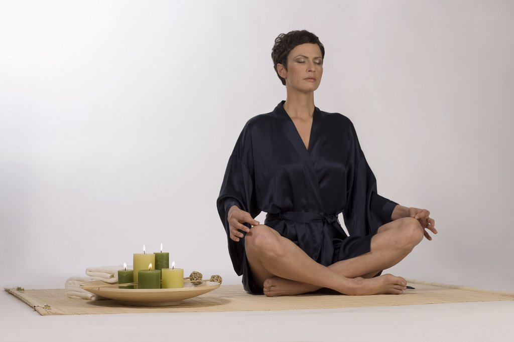 Stock Photo: 1815R-37222 Woman meditating on yoga mat