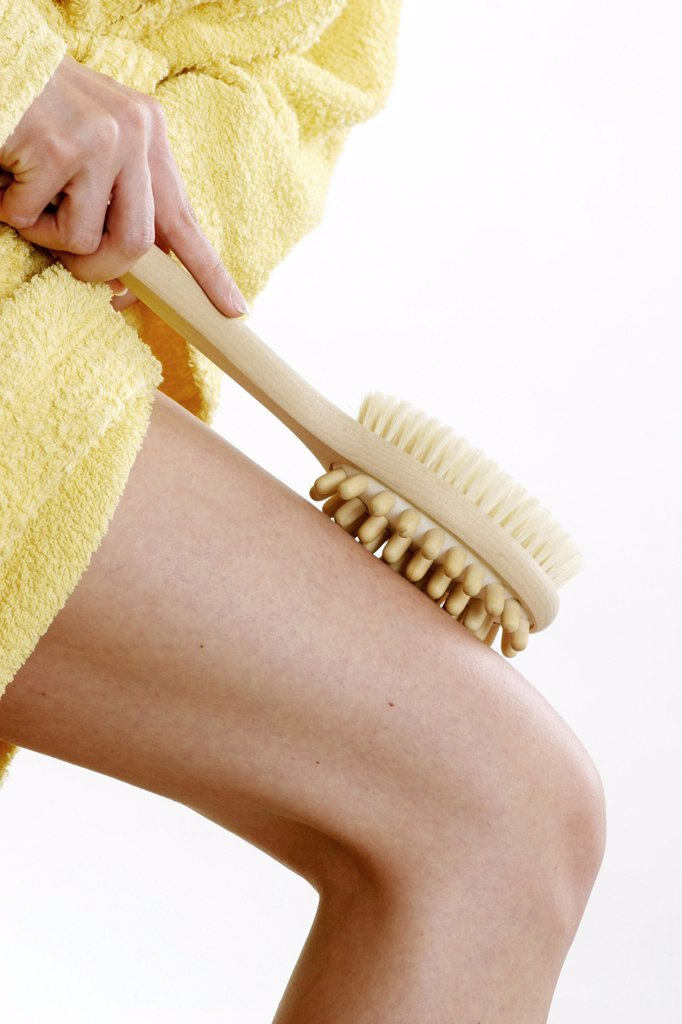 Woman with massage brush, close-up : Stock Photo