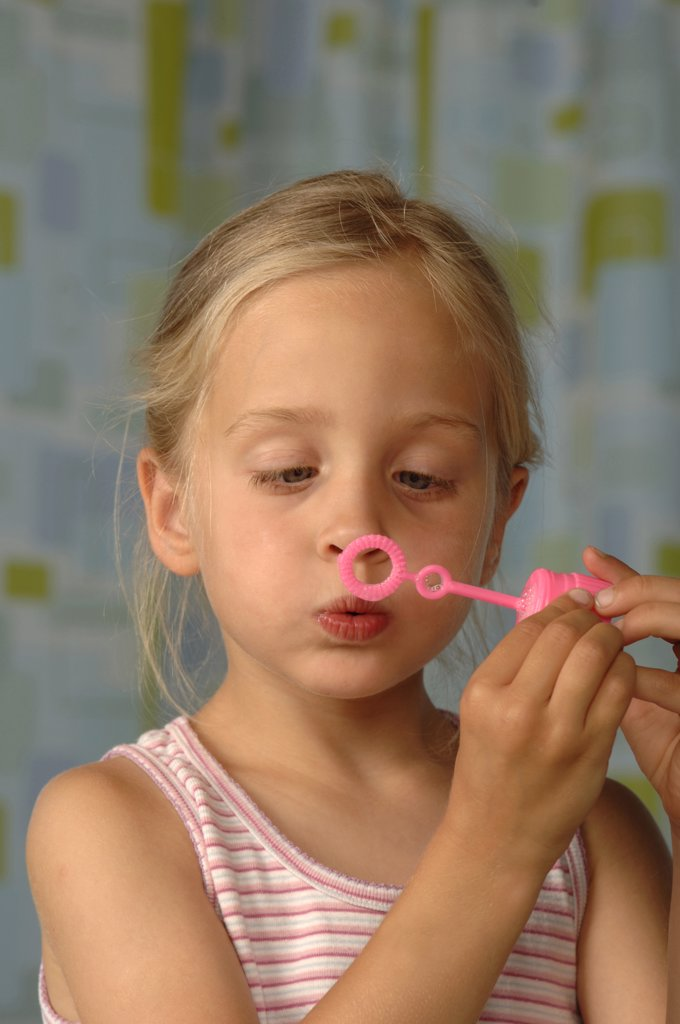 Girl making soap bubbles : Stock Photo