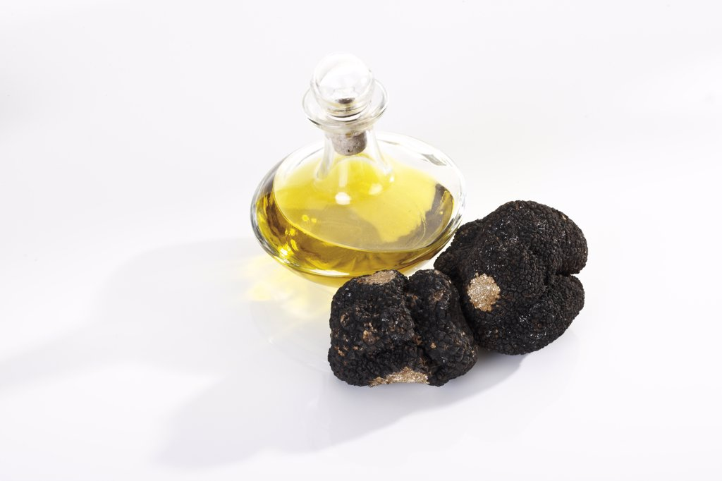 Black Truffles and a bottle of oil, elevated view : Stock Photo