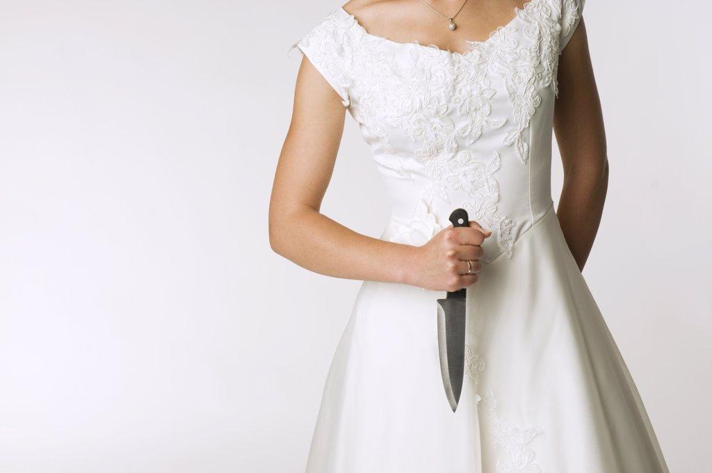 Bride holding knife, mid section : Stock Photo