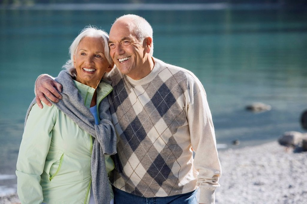 Germany, Bavaria, Walchensee, Senior couple embracing, smiling : Stock Photo