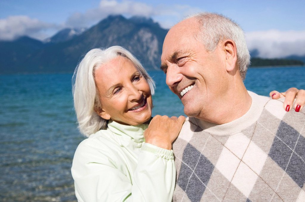 Stock Photo: 1815R-48926 Germany, Bavaria, Walchensee, Senior couple smiling, portrait