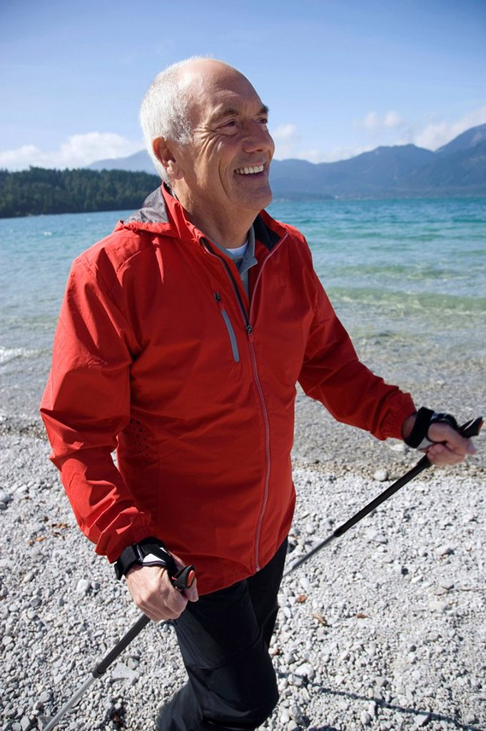 Germany, Bavaria, Walchensee, Senior man with walking sticks : Stock Photo