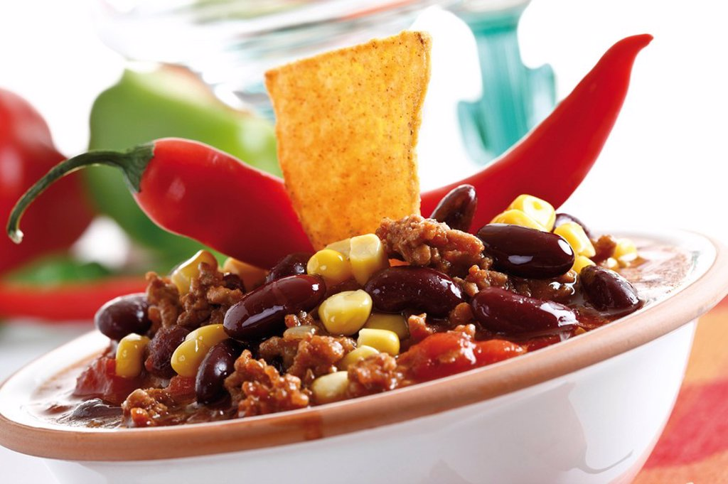 Chili con Carne with Tortilla chip on plate : Stock Photo