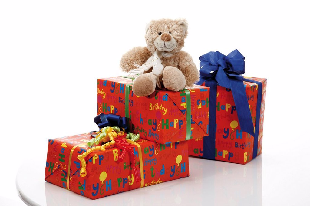 Stock Photo: 1815R-51632 Teddy bear on gift parcels