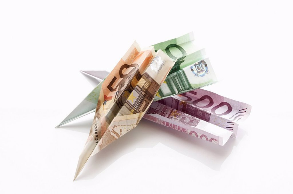 Stock Photo: 1815R-52237 Paper aeroplanes folded from Euro banknotes