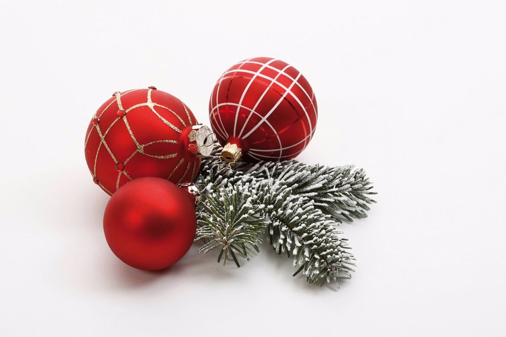 Christmas decoration, red christmas baubles and fir twig : Stock Photo