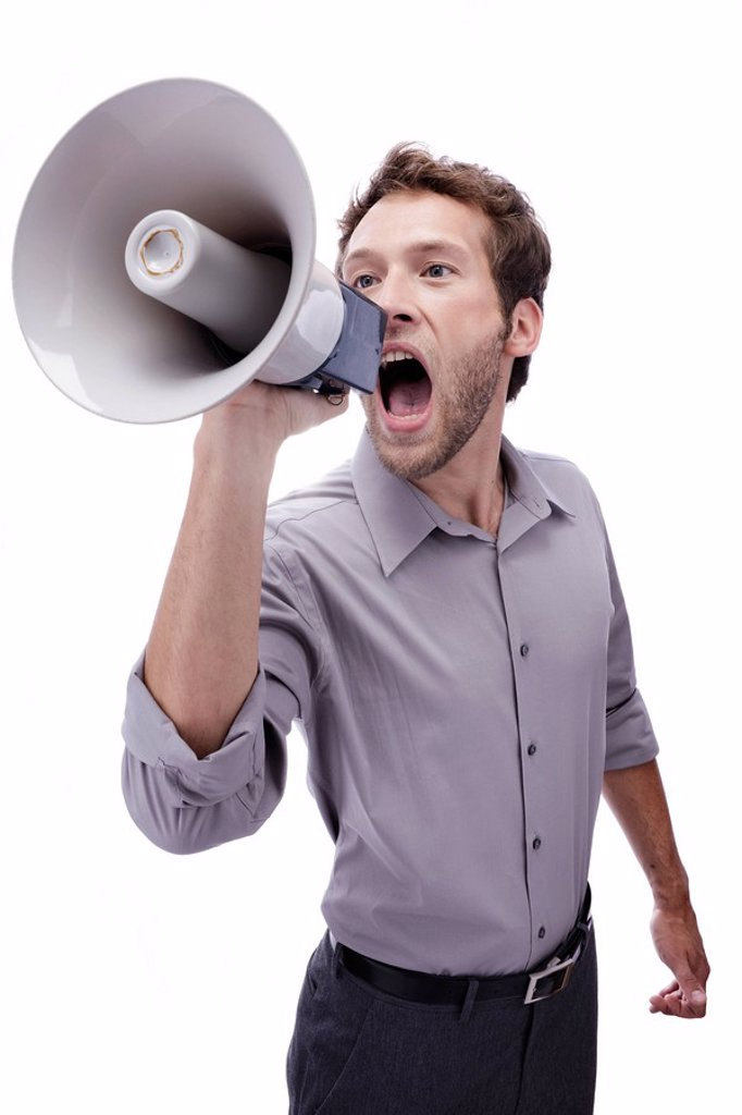 Young man holding megaphone, portrait : Stock Photo