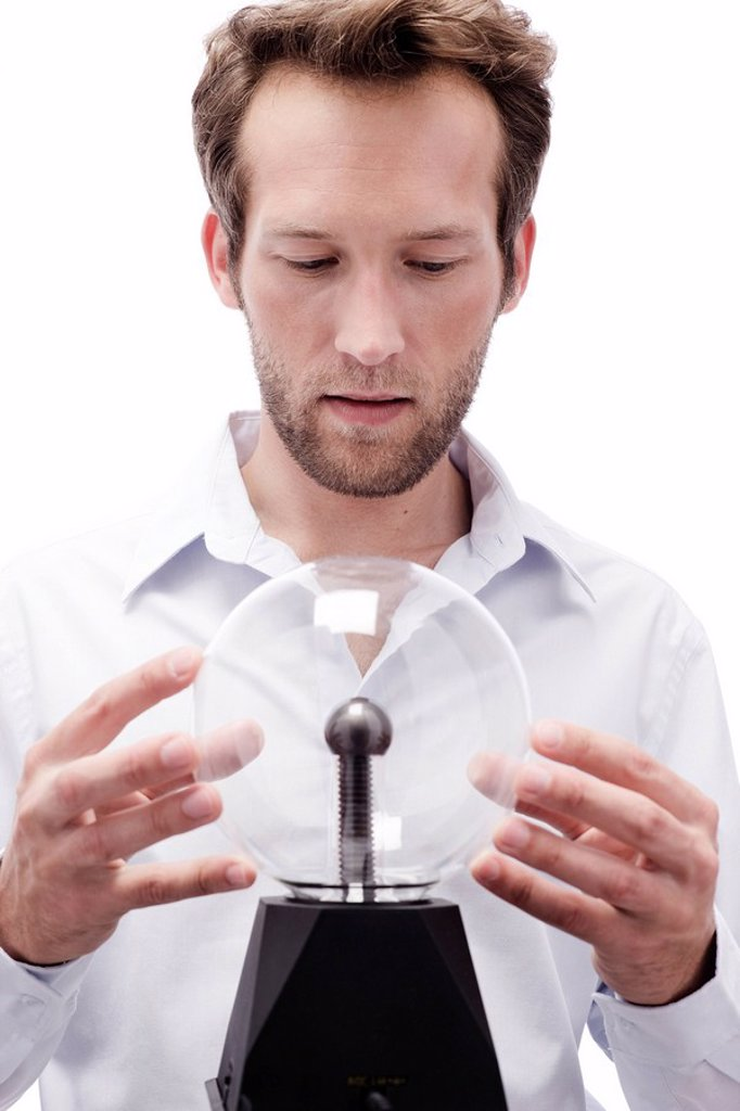 Young man with crystal ball, portrait : Stock Photo