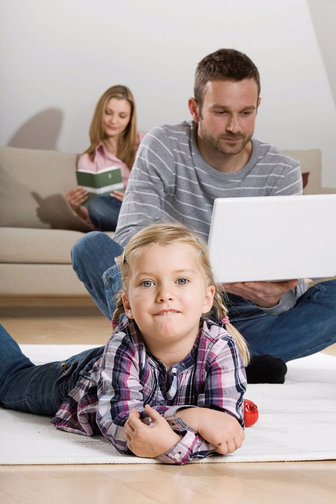 Parents and daughter at home : Stock Photo
