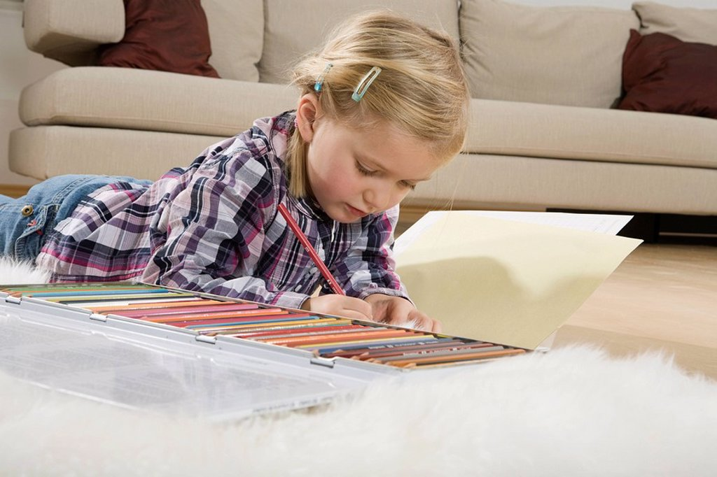 Stock Photo: 1815R-54144 Little girl 3_4 crayoning