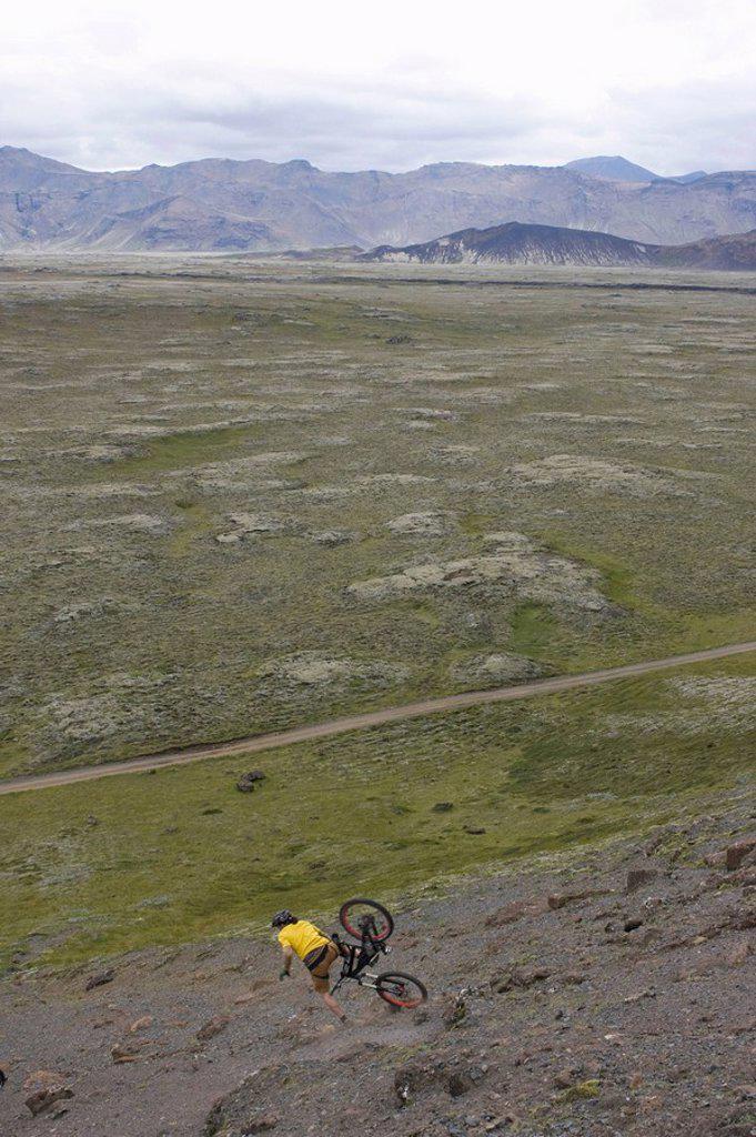 Iceland, Man mountain biking downhill : Stock Photo