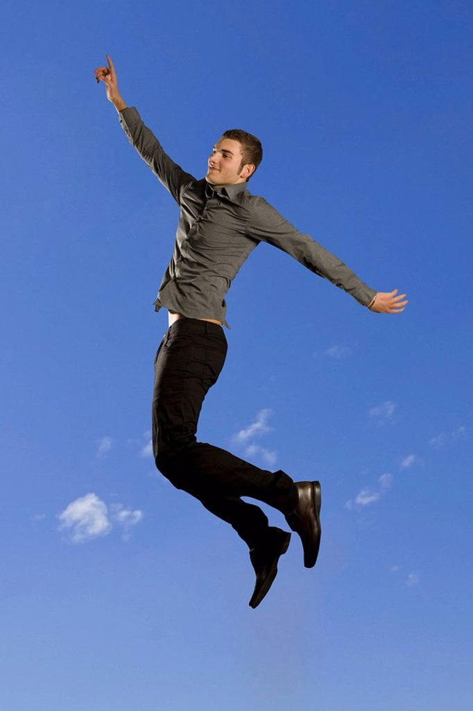 Man levitating, side view : Stock Photo