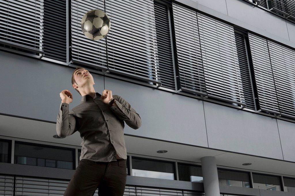 Man heading ball : Stock Photo