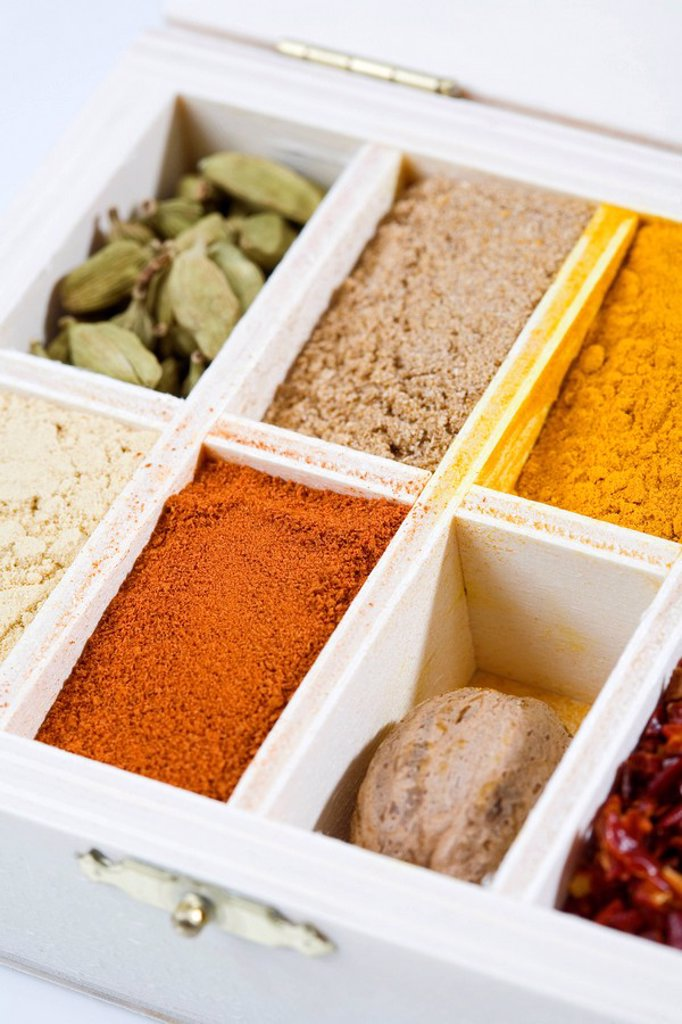 Variety of spices in wooden box, elevated view, close_up : Stock Photo