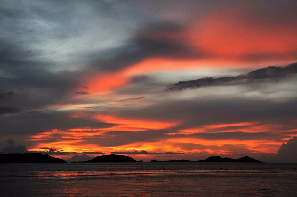 Asia, Indonesia, Sunset over Komodo Island. : Stock Photo