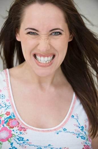Stock Photo: 1815R-58794 Woman clenching her teeth, close_up