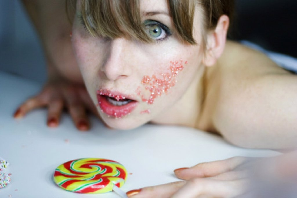 Stock Photo: 1815R-58904 Young woman with lolly