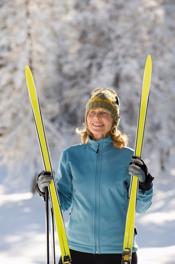 Stock Photo: 1815R-58932 Austria,Tyrol, Seefeld, Wildmoosalm, Woman holding cross_country skis