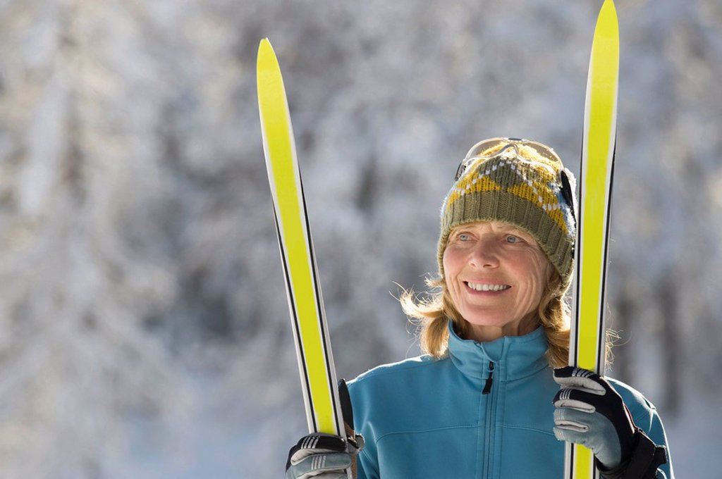 Austria,Tyrol, Seefeld, Wildmoosalm, Woman holding cross_country skis : Stock Photo