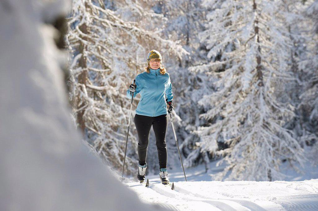 Austria, Tyrol, Seefeld, Woman cross country skiing : Stock Photo