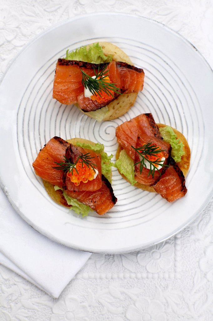Appetiser, Canapes with salmon, dill and trout caviar on plate, elevated view : Stock Photo