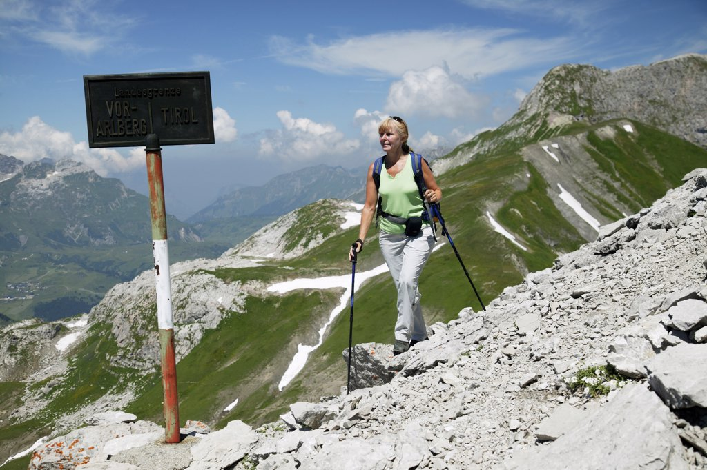 Woman hiking in austrian alps : Stock Photo