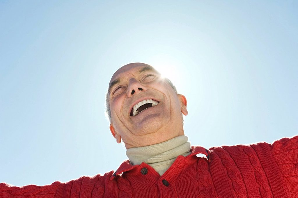 Italy, South Tyrol, Seiseralm, Senior man laughing, low angle view, portrait : Stock Photo