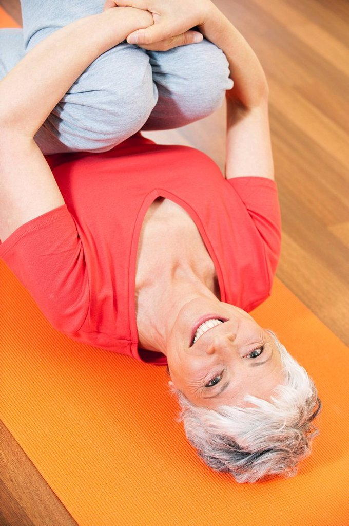 Senior woman exercising pilates, elevated view, portrait : Stock Photo