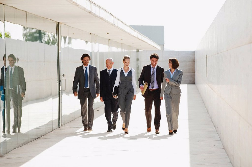 Spain, Mallorca, Business people walking together : Stock Photo