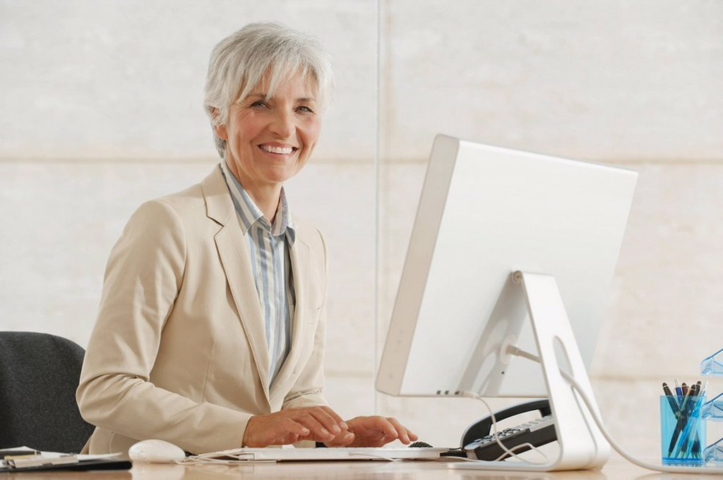 Senior Businesswoman using computer : Stock Photo