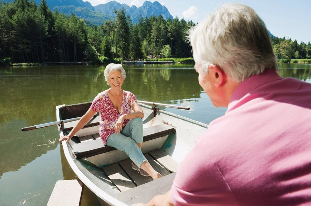 Italy, South Tyrol, Senior couple in rowing boat, portrait : Stock Photo