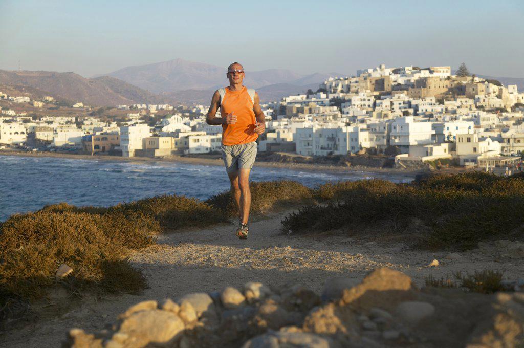 Greece, Naxos, jogging on the coast : Stock Photo