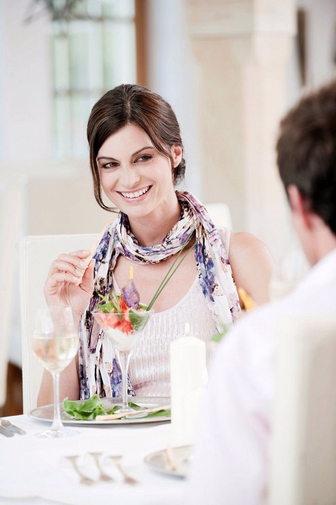 Couple sitting in restaurant : Stock Photo