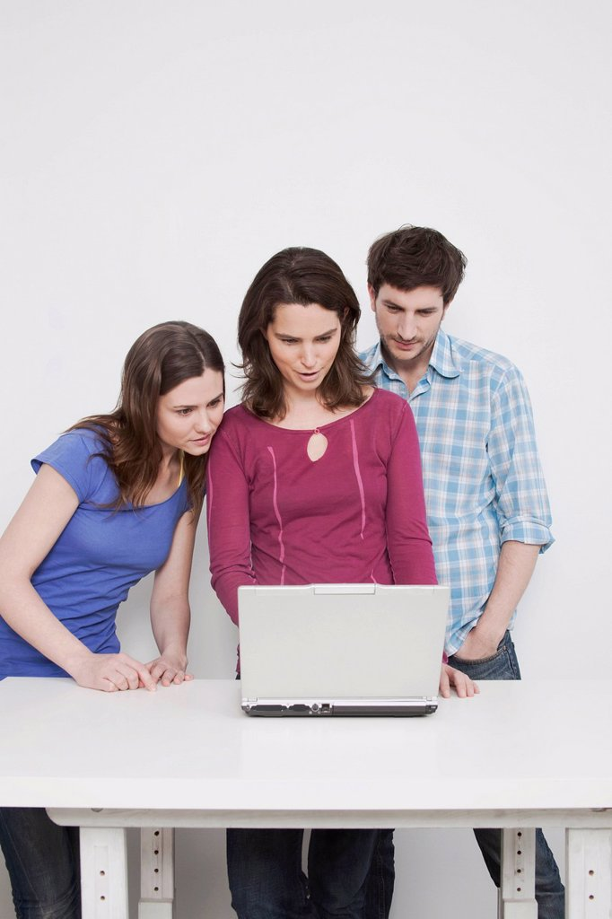 Stock Photo: 1815R-66570 Man and women using laptop